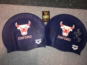 Our arena #ragingbulls swim caps that were signed by Adam Peaty and Alys Thomas